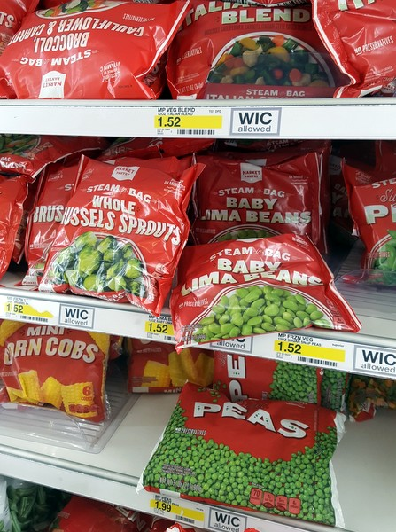 Frozen peas & other vegetables on a shelf
