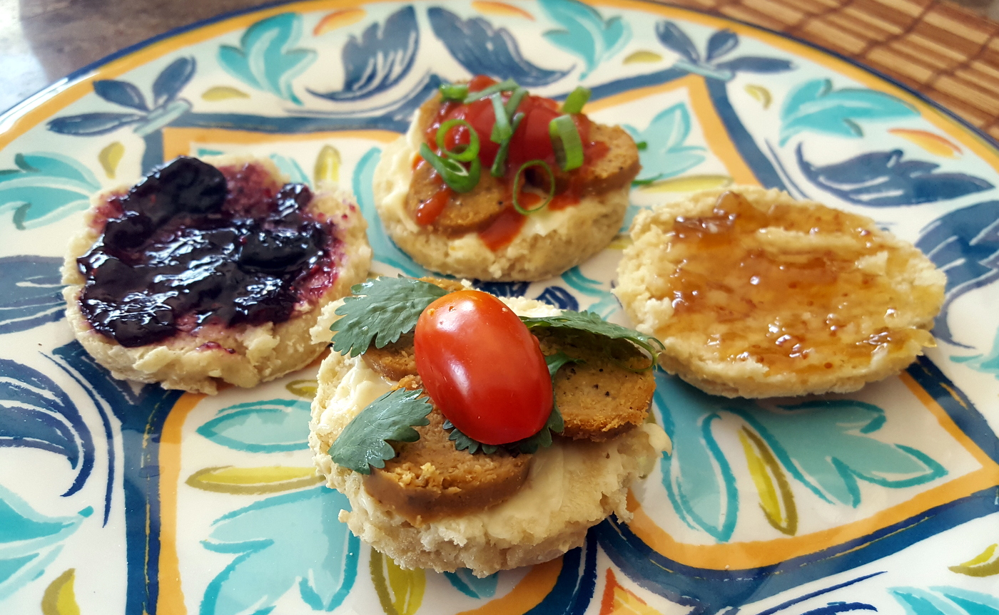 Plate of vegan sausage biscuits and biscuits with jelly